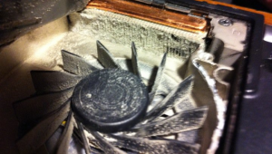 An image of my Dell Studio's dust clogged fan and heat sink.